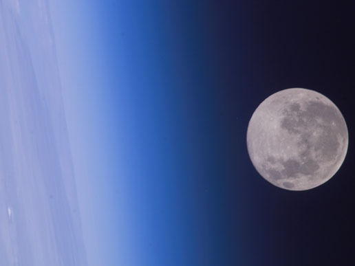 Full moon floats in space