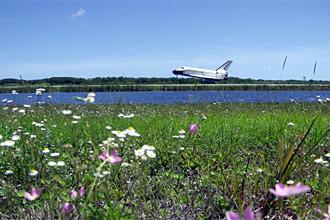 Orbiter Atlantis lands at Kennedy Space Center after mission STS-110