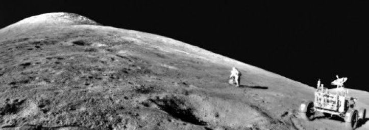 Apollo 15 astronaut Dave Scott ascends the cushiony base of Mt. Hadley Delta.