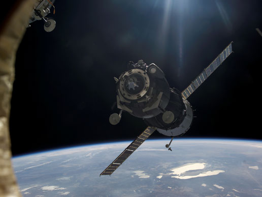 Carrying the Expedition 12 crew, a Soyuz TMA-7 approaches the International Space Station.