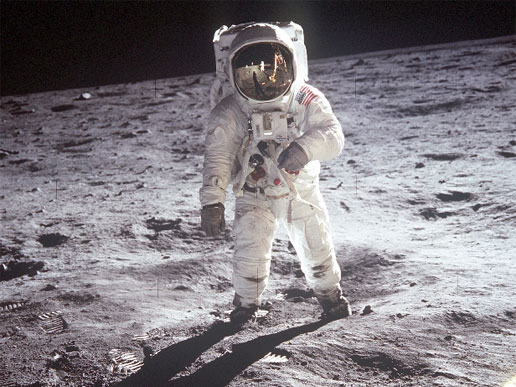 Astronaut Edwin E. Aldrin, Jr., lunar module pilot, walks on the surface of the Moon near the leg of the Lunar Module (LM)