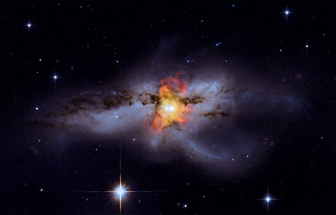 Composite images of two colliding black holes. Click for a bigger version. Image credit: Chandra, Hubble