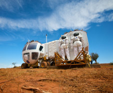 Space Exploration Vehicle docking with Cabin A for a simulated rescue mission. This simulated mission was part of the 2009 Desert RATS held at Black Point Lava Flow in Arizona. Photo Credit: NASA (Click image for fullsize.)