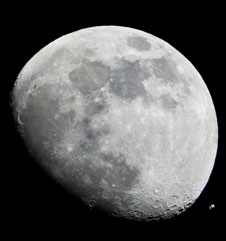 JSC2012-E-017833 -- The International Space Station can be seen as a small object in lower right of this image of the moon