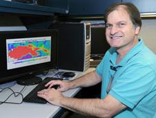 smiling guy at a computer terminal
