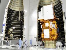 Image above: Technicians encapsulate the NASA's LDCM satellite in its payload fairing. Photo credit: NASA/VAFB