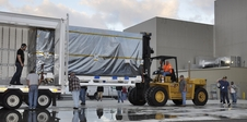 NASA's Soil Moisture Active Passive (SMAP) spacecraft is delivered by truck to the Astrotech payload processing facility at Vandenberg Air Force Base in California on Wednesday, Oct. 15, 2014.