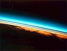 Layers of the upper atmosphere looked at from the edge, shown in colors ranging from red near the earth to blue towards space