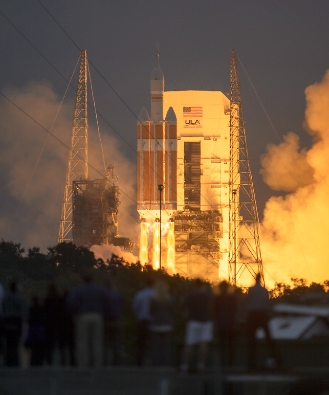 The United Launch Alliance Delta IV Heavy rocket, with NASA's Orion spacecraft mounted atop, lifts off from Cape Canaveral Air Force Station