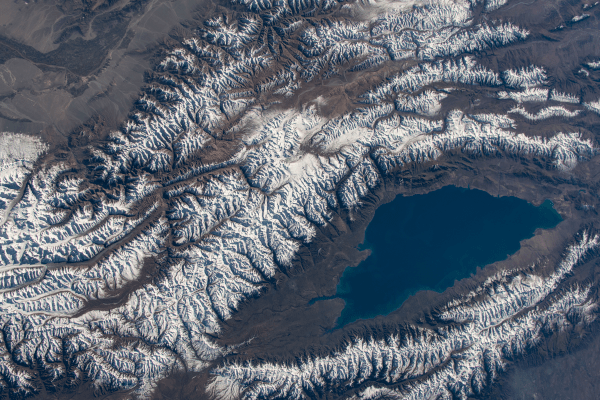 snowy mountain tops as seen from space