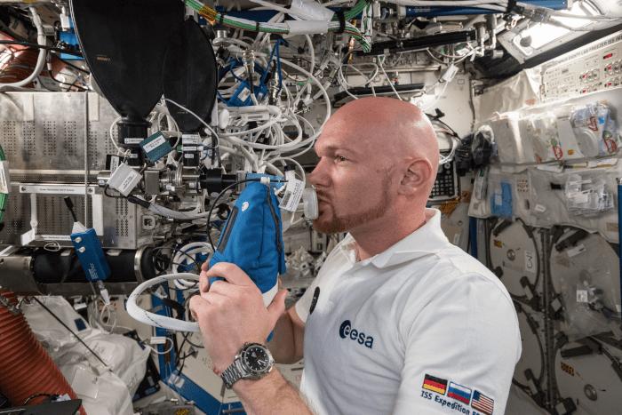 astronaut Alexander Gerst exhales into an ultra-sensitive gas analyzer