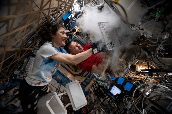astaonauts andrew morgan and christina koch prepping samples for cold stowage