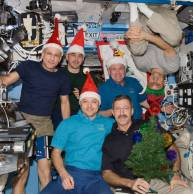 exp_30_crew_with_santa_claus_hats