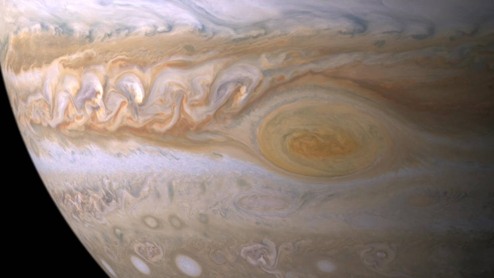 Trapped between two jet streams, the Great Red Spot is an anticyclone swirling around a center of high atmospheric pressure that makes it rotate in the opposite sense of hurricanes on Earth.