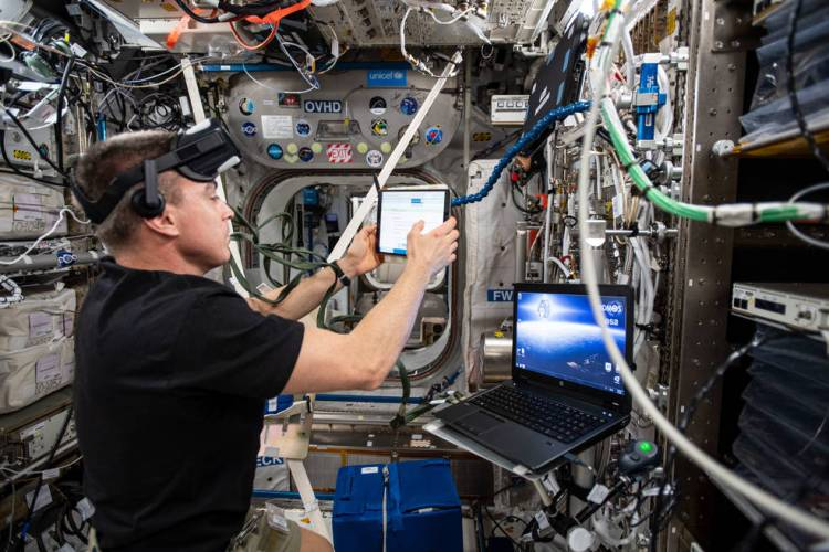 Expedition 63 Commander Chris Cassidy during the preparation of the Vection experiment
