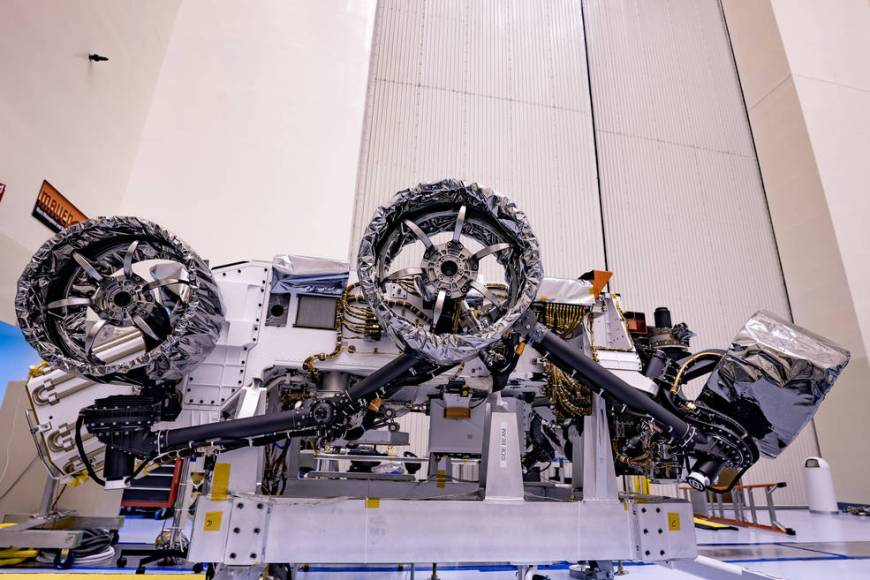 Wheels are installed on NASA's Mars Perseverance rover at Kennedy Space Center