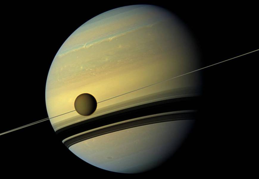 Titan is seen here as it orbits Saturn