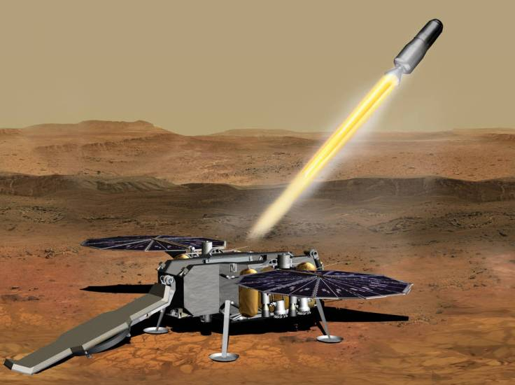 This illustration shows a concept of the NASA Mars Ascent Vehicle, carrying tubes containing rock and soil