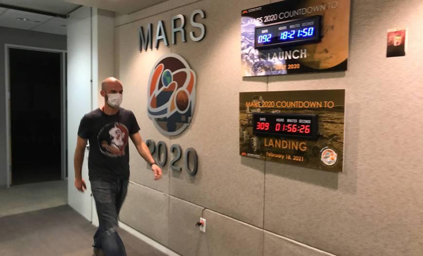 Ian Clark walks past mission countdown clocks