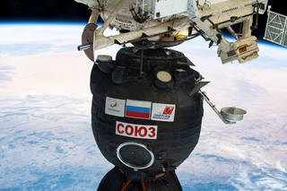 Soyuz spacecraft docked to the space station