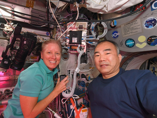 astronauts Shannon Walker and Soichi Noguchi talking to junior high schoolers in Japan