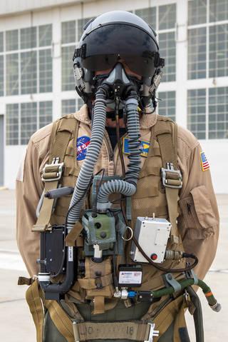 NASA research pilot Jim Less wears a U.S. Navy harness configuration of JPL prototype mask.