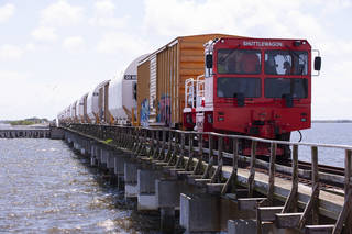 A train transporting the 10 booster segments for NASA's Space Launch System rocket