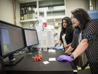 Jennifer Domanowski (forefront) and Nithin Abraham begin evaluating the effectiveness of a NASA-developed adsorber coating.