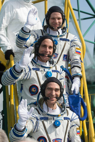 Expedition 63 crewmembers Ivan Vagner of Roscosmos, top, Chris Cassidy of NASA, center, and Anatoly Ivanishin