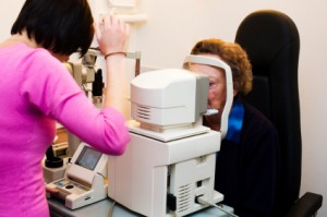 elderly woman getting glaucoma test