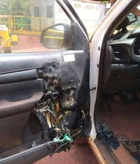 Photo of a car door that has been damaged in a fire
