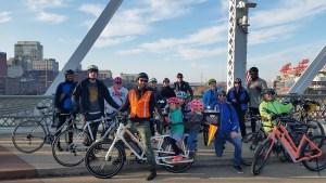 Bike Fun Pizza Party riders on the pedestrian bridge downtown.