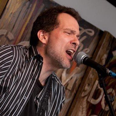 Dave Isaacs playing and singing