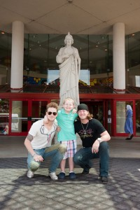 Florida Georgia Line with patient Tyler in front of the St. Jude statue at the hospital's main entrance.