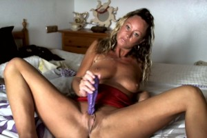 Natalie K on bed with toy