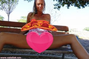 Natalie K outdoors flashing in Public