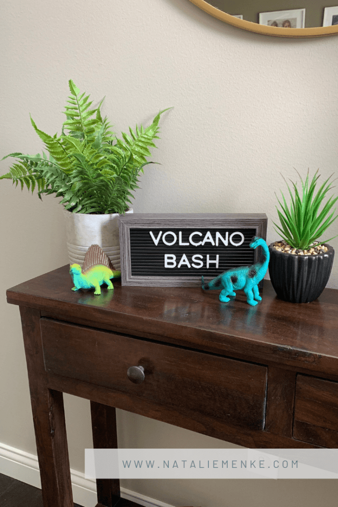"""Volcano birthday party """"Volcano Bash"""" entrance sign with prehistoric ferns and dinosaur accents from www.nataliemenke.com"""