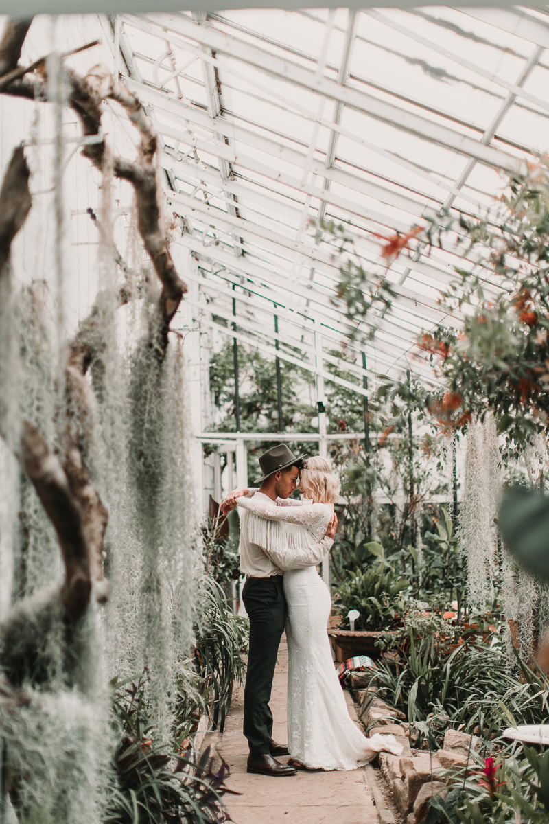 Wedding dress with tassels in a palm house is the perfect inspiration for all you Boho babes out there. Blush and green Bohemian Wedding Inspiration bringing a little California to you where ever you are in the world. Relaxed styling and desert inspiration and vibes. Wedding ideas for boho brides who an effortlessly relaxed, bohemian wedding. Shot by Natalie Pluck Photography. See full blog post for credits and more inspiration here http://www.nataliepluck.com/bohemian-wedding-inspiration/ 