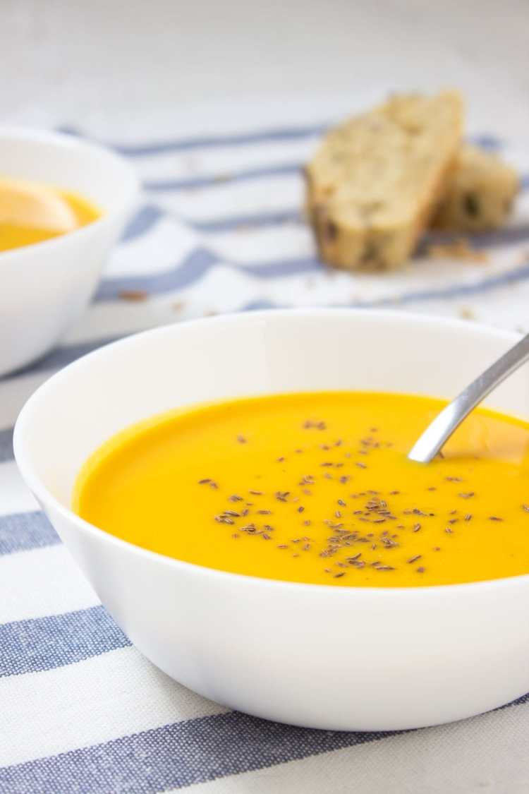 Easy Carrot Ginger Soup made with all healthy ingredients, enriched with healing spices - ginger and turmeric. Low-fat and warming, this immune boosting soup makes a healthy lunch or dinner. CLICK to read more or PIN fro later! natalieshealth.com #vegan #glutenfree #dairyfree #dinner #soup #easy #vegetarian #paleo
