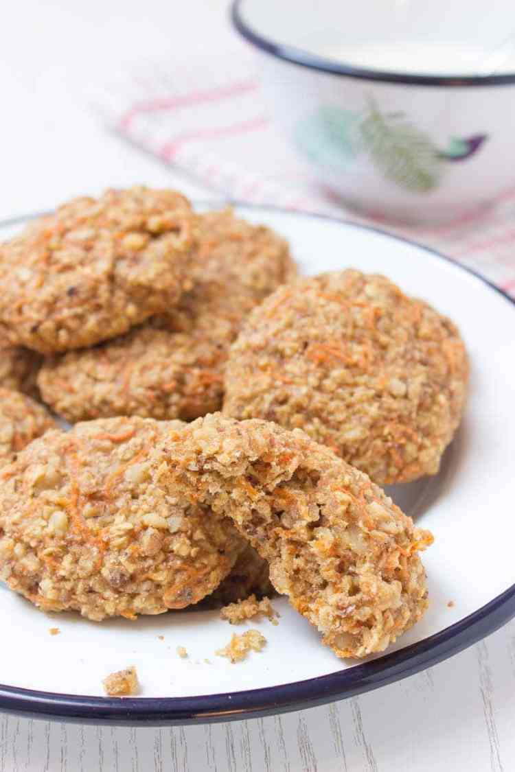 Healthy wholegrain Carrot Cake Oatmeal Cookies filled with oats, grated carrots, ginger, and walnuts. These cookies are low-fat, refined sugar-free, kid-friendly and super easy to make. Perfect breakfast or snack. #sugarfree #healthy #easy #snack #brakfast #cookies #easter #spring