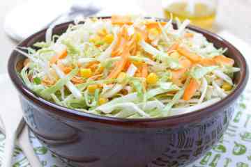 Cabbage Carrot Slaw made with FRESH veggies - green cabbage, carrots, celeriac root and sweet corn is the ultimate summer salad. Crunchy, sweet and tangy with the touch of ginger freshness, this salad is both delicious and ridiculously simple! #healthy #coleslaw #salad #bbq #summer #spring #vegan #glutenfree #vegetarian   natalieshealth.com