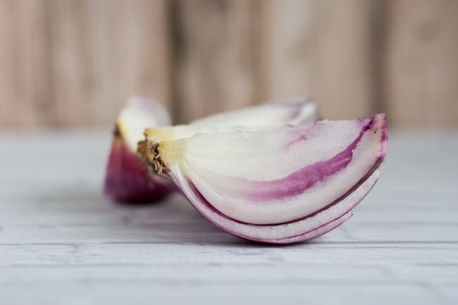 peeled and quartered red onion