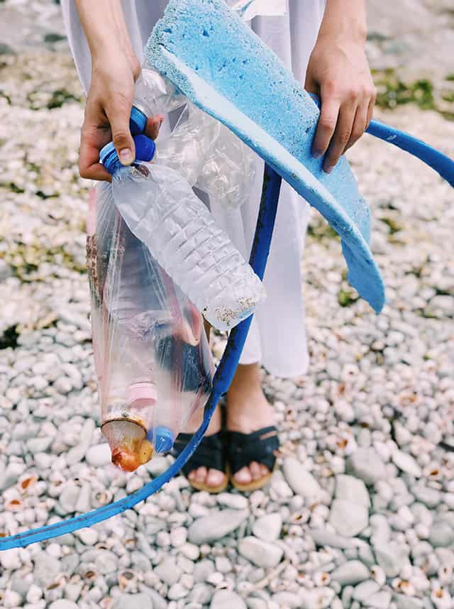 picking up litter on the beach