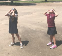 Lily Liles and Leigha Busby saw the eclipse from Exchange Bank on South Drive.