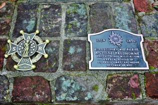 The two markers placed on the grave of Antoine Prudhomme by the DAR and SAR.