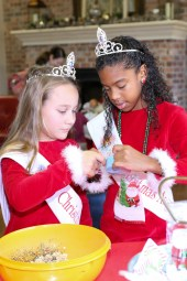 Angels Campbell Morrow and Cayla Anthony make reindeer food.
