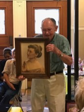 "Bob Porter with a portrait of the ""love of his life,"" the late Mrs. Shirley Porter."