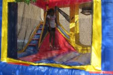 Genesis Washington, 7, plays in the bounce house.