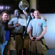 First place - Firebusters (John Wynn, Irving Barfield and Brent Dupree) pictured with Rodney Harrington.