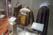 Several uniforms from various service men and women are featured in the exhibit.